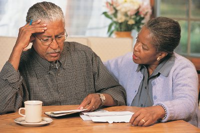 Senior Couple Going Over Bills --- Image by © Ocean/Corbis